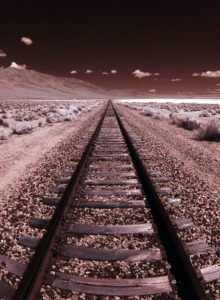 Railroad Tracks to Horizon on a Salt Flat